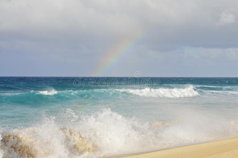 Oahu North Shore, Hawaii. Rainbow over the Ocean; Banzai Pipeline Beach, North Shore, Oahu royalty free stock photography