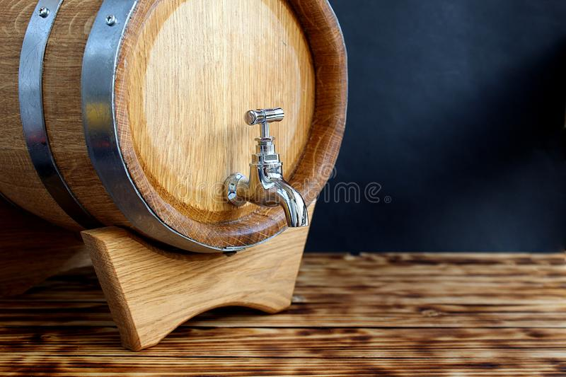 Oak barrel with tap for cognac aging. Barrel, beer, wine, background, oak, wooden, wood, rum, old, brown, retro, object, whiskey, drink, liquid, alcohol, winery stock image