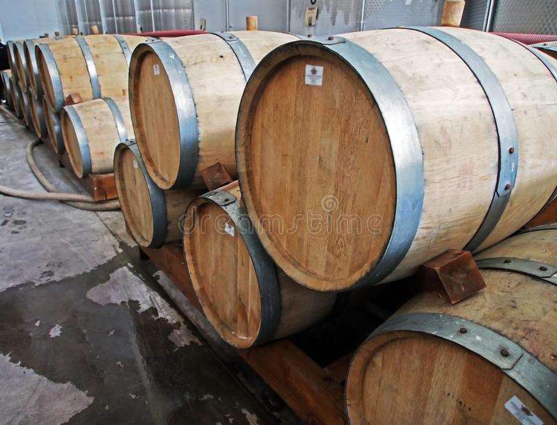 Oak barrels with ready-to-ship cognac. At a wine factory in Georgia royalty free stock photos