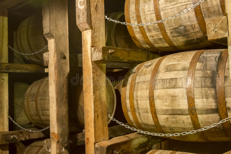 Oak bourbon barrels on rack in warehouse royalty free stock images