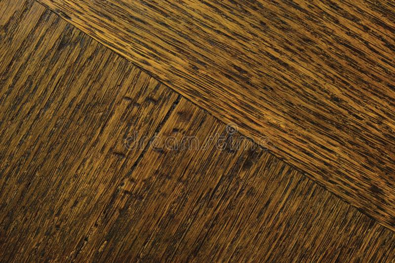 Oak grain veneer texture background, dark black brown natural parquet parquetry horizontal scratched textured diagonal pattern royalty free stock photography