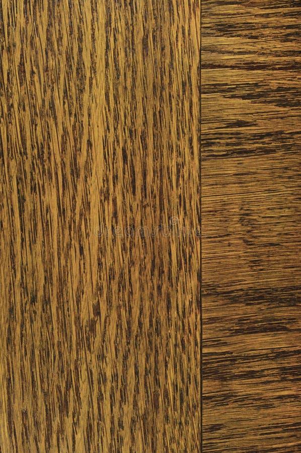Oak grain veneer texture background, dark black brown natural vertical scratched textured pattern large detailed rugged wood macro royalty free stock image