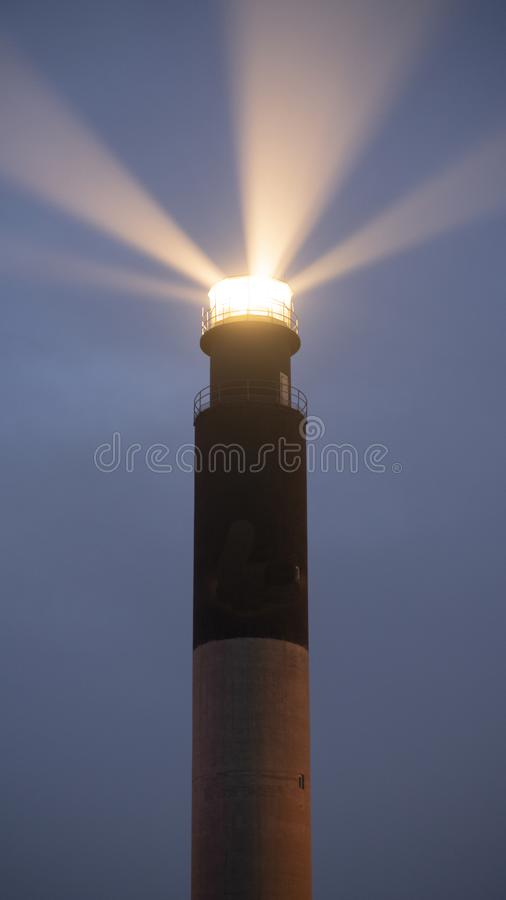 Oak Island Lighthouse Beams into the Seafoam at Fort Caswell royalty free stock image