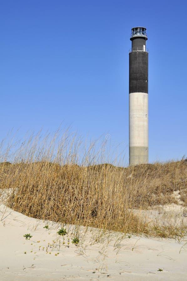 Oak Island Lighthouse Vertical. Oak Island Lighthouse, Caswell Beach, Oak Island, North Carolina vertical in winter with copy space royalty free stock photos