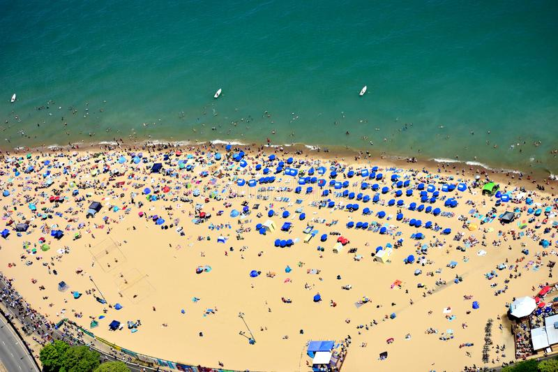 Mass tourists at Oak Street beach in Chicago, IL. USA royalty free stock images