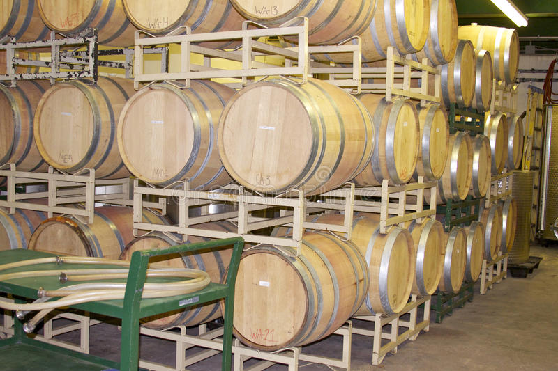 Oak Wine Barrels in a Rack. Wine barrels full of aging wine and stored in a rack at the Brushy Creek Winery in Texas stock photos