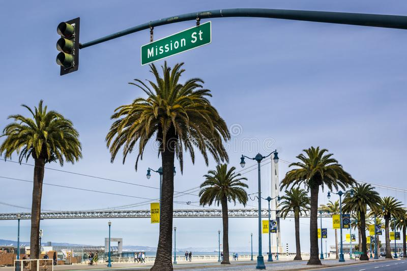 Oakland Bay Bridge and Palm Trees, San Francisco, California, United States of America, North America. San Francisco, USA - June 9 2018: Oakland Bay Bridge and stock photo