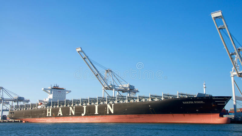 Cargo Ship HANJIN JUNGIL awaits assistance to depart from the Port of Oakland. Oakland, CA - September 29, 2016: All visible cargo unloaded from the vessel stock photo