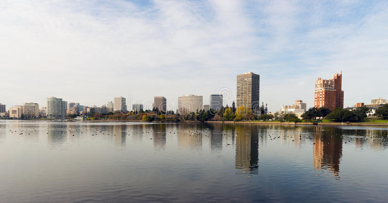 Oakland California Afternoon Downtown City Skyline Lake Merritt. An overcast sky is reflected in the smooth water of Lake Merritt in front of Oakland royalty free stock image