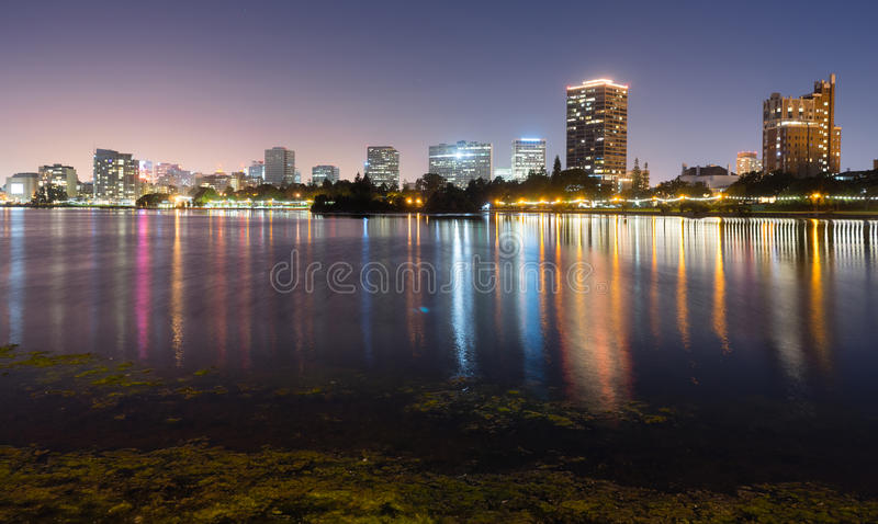 Oakland California Night Sky Downtown City Skyline Lake Merritt. Smooth water of Lake Merritt in front of Oakland royalty free stock photography