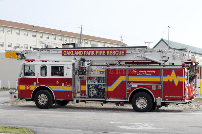 Oakland Park Fire Rescue Truck. FORT LAUDERDALE, FLORIDA - FEBRUARY 13, 2013: One long Oakland Park fire rescue firemedics truck with ladder that has various royalty free stock photos