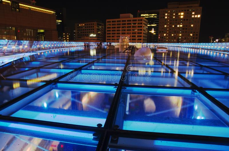 Oasis 21 building in night, Nagoya, Japan. Blue lights over roof floor of Oasis 21. The Oasis 21 is a modern bulding located near to the Nagoya TV Tower in Sakae stock photo
