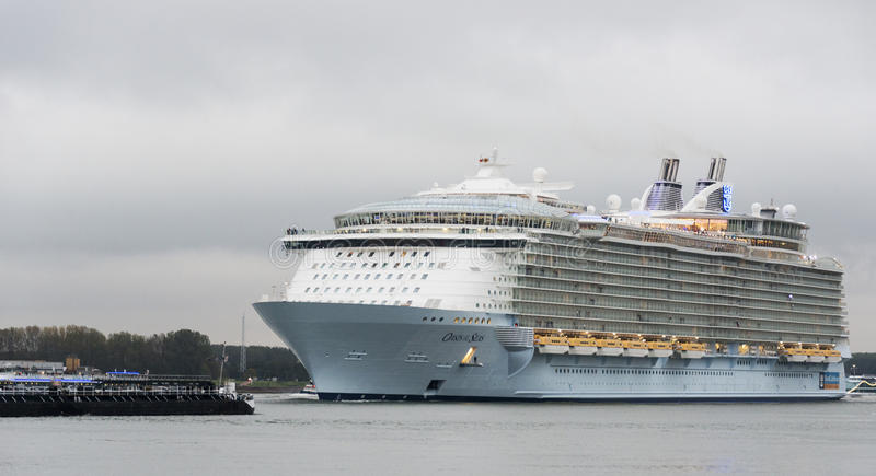Oasis of the seas. The oasis of the seas leaving the rotterdam harbor to southampton on Okt 2014 in Rotterdam,this is the biggest cruise ship in the world stock images