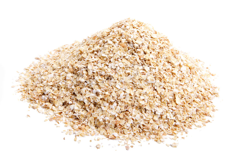Oat bran. Wheat oat on white background. It is common ingredient of healthy meal stock photo