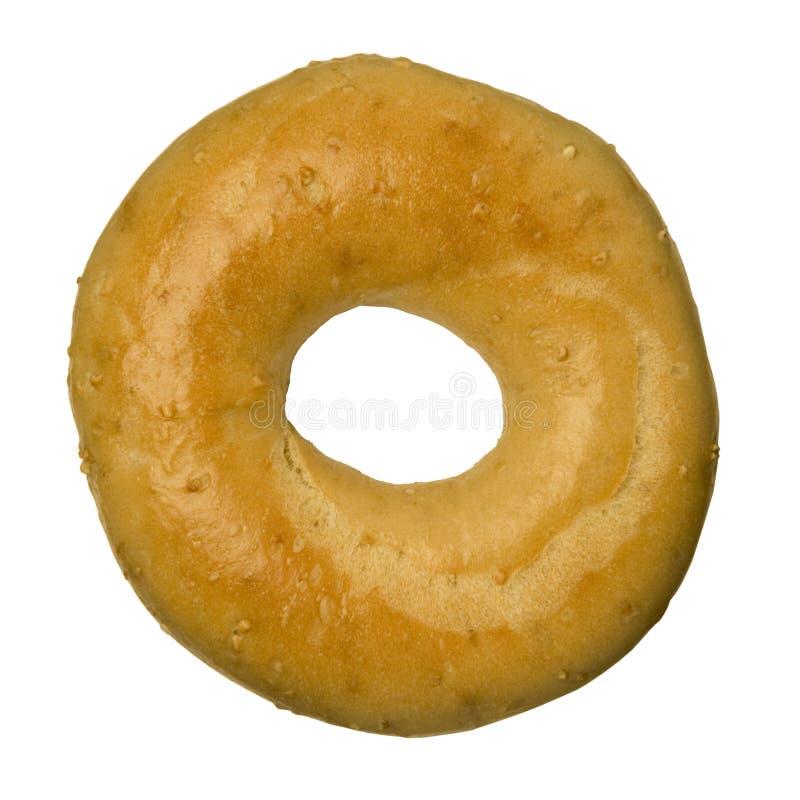 Oat bran bagel against white stock photos