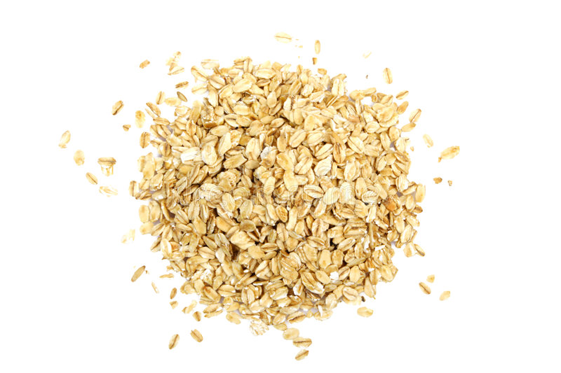 Oat cereal. On white background. It is common ingredient of healthy meal royalty free stock image