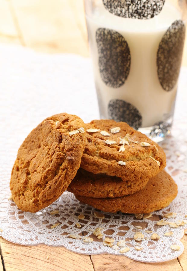 Oat cookies and a glass of milk stock photos