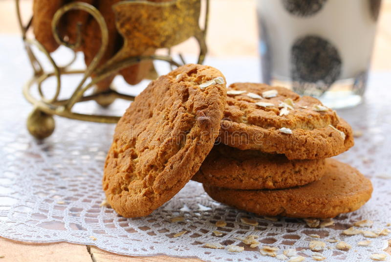 Oat cookies and a glass of milk royalty free stock photos