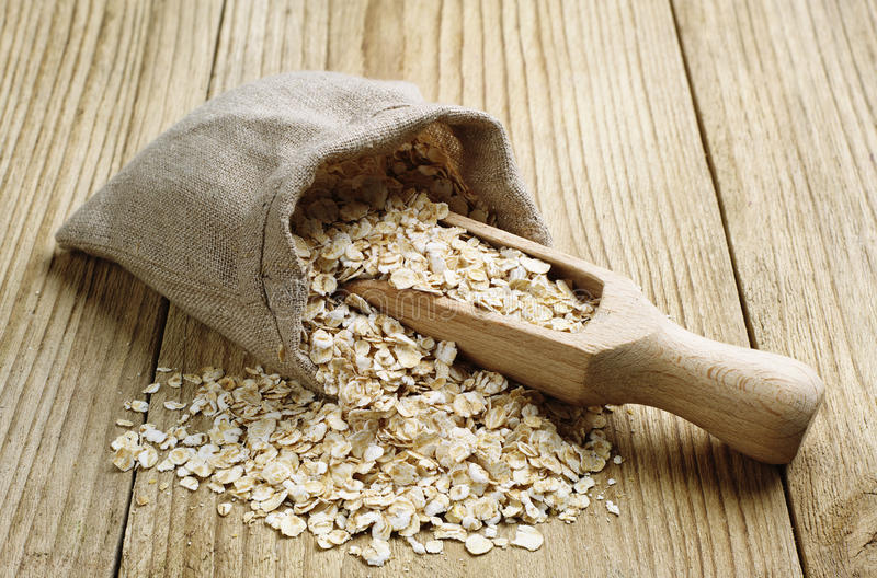 Download Oat flake in a sack stock photo. Image of cereal, wooden - 29857604