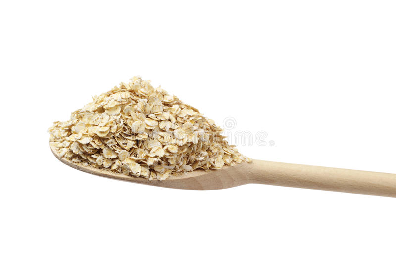 Oat Flake On The Wooden Spoon Stock Photography