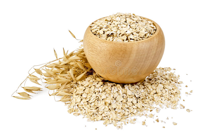 Oat flakes in a bowl royalty free stock photo