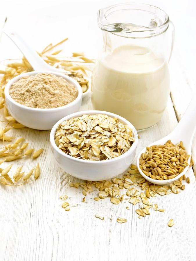 Oat flakes with flour and milk on light board stock images