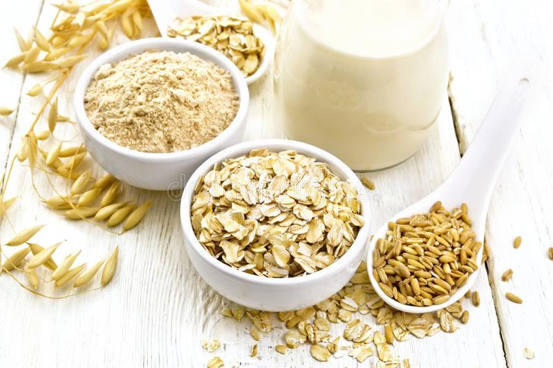 Oat flakes with flour and milk on table royalty free stock images