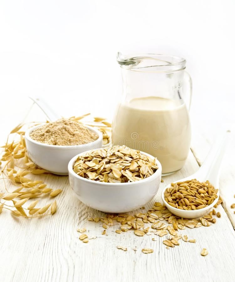 Oat flakes with flour and milk on white board stock photos