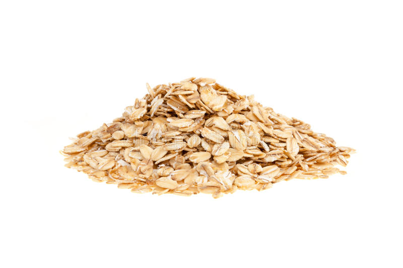 Oat flakes. Heap of oat flakes - isolated on a white background royalty free stock photos