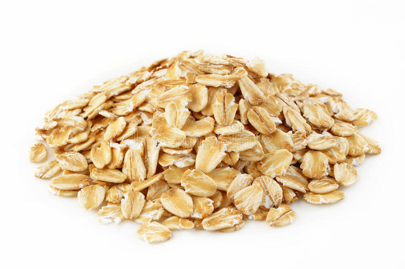 Oat Flakes. On white background royalty free stock images