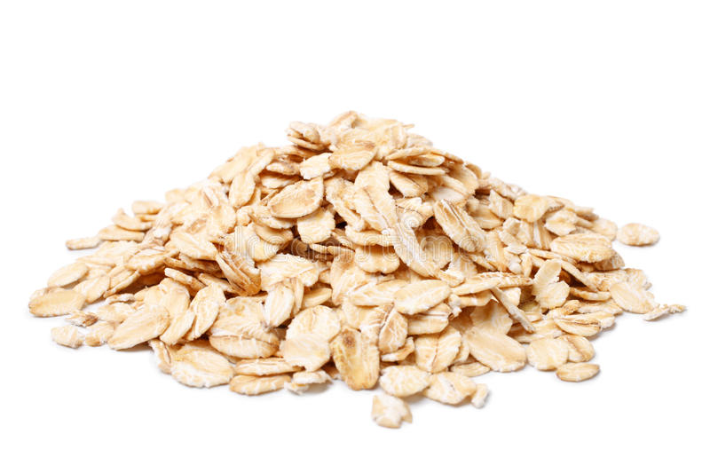 Oat flakes. On white background stock photos