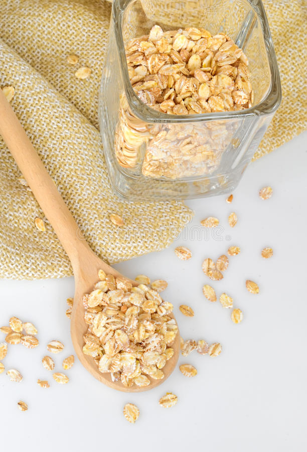 Download Oat-flakes With A Wooden Spoon Stock Photo - Image: 23871496