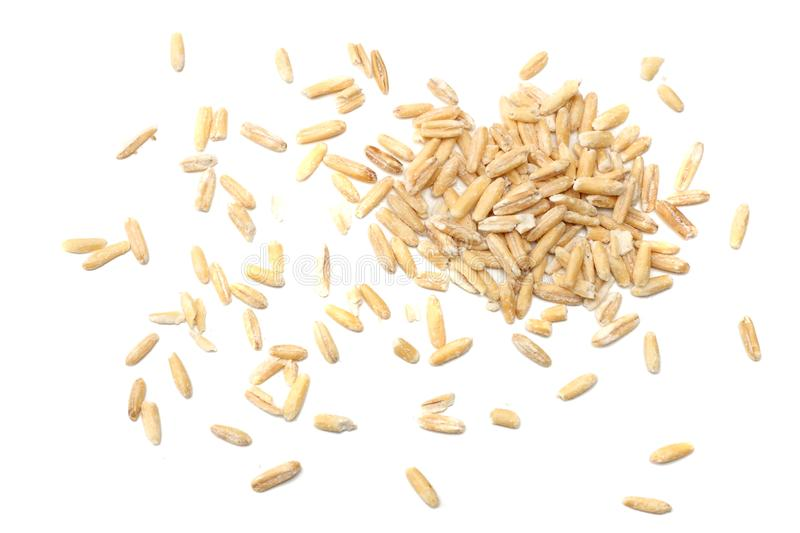 oat grains isolated on white background. top view royalty free stock photography