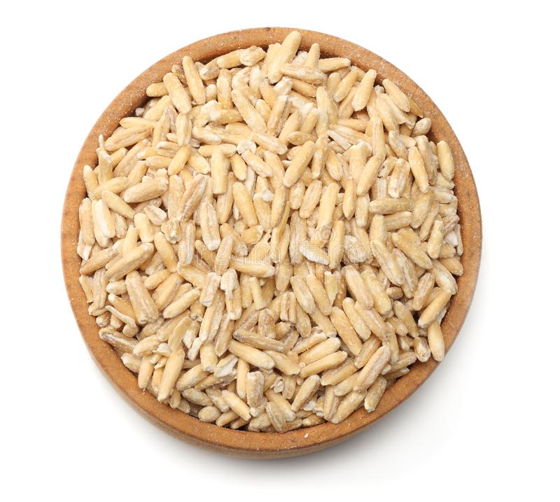 oat grains in wooden bowl isolated on white background. top view stock photo