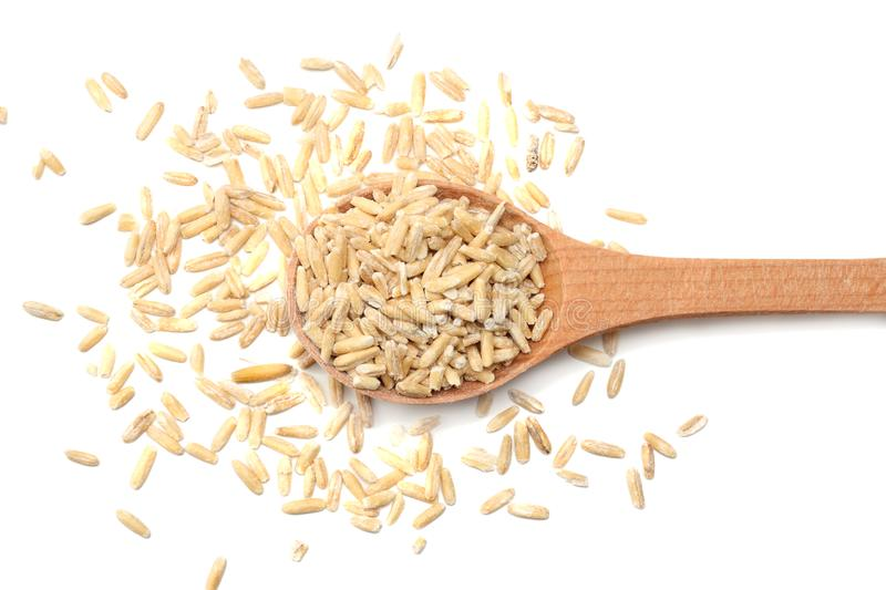 oat grains in wooden spoon isolated on white background royalty free stock photography