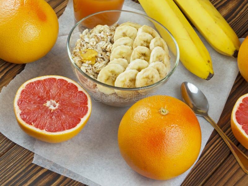Oat porridge with banana and grapefruit juice stock photography