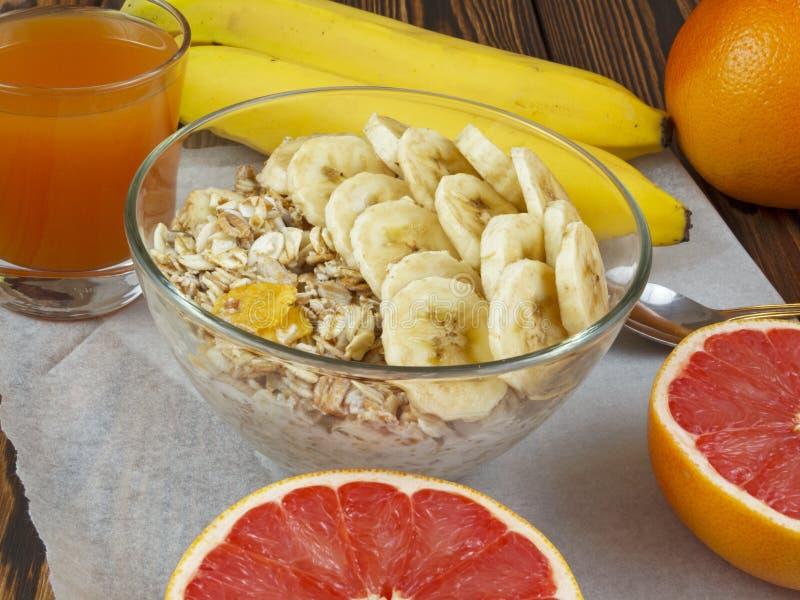 Oat porridge with banana and grapefruit juice royalty free stock images