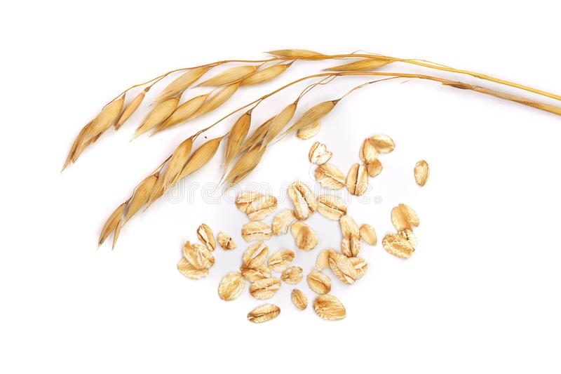Oat spike with oat flakes isolated on white background royalty free stock photos