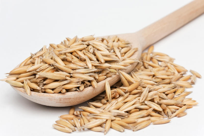 Oat  With A Wooden Spoon Royalty Free Stock Photography
