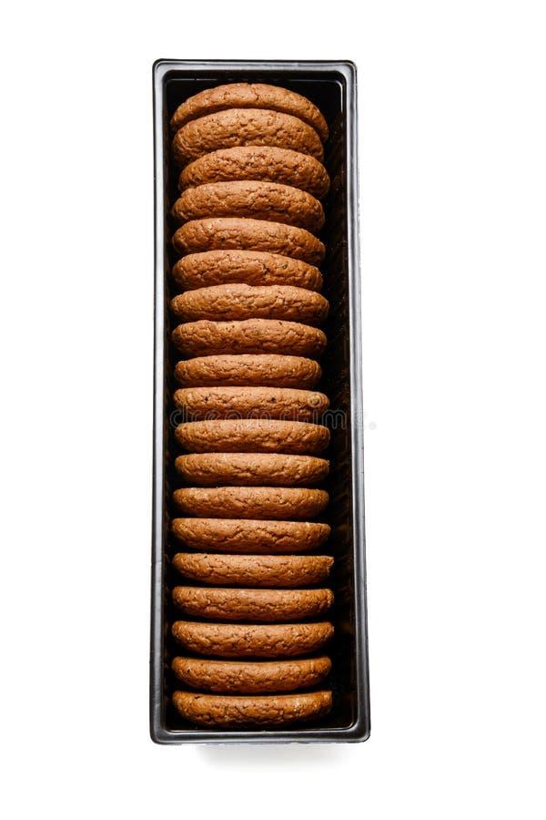Oatmeal μπισκότα στην πλαστική συσκευασία Άσπρη απομονωμένη ανασκόπηση Κινηματογράφηση σε πρώτο πλάνο Τοπ όψη στοκ εικόνα με δικαίωμα ελεύθερης χρήσης