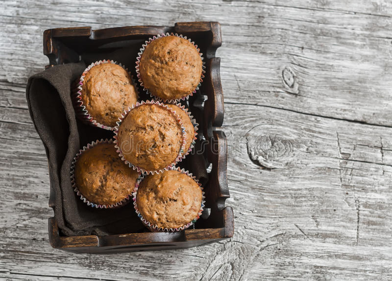 Oatmeal and banana muffins in vintage tray stock photography