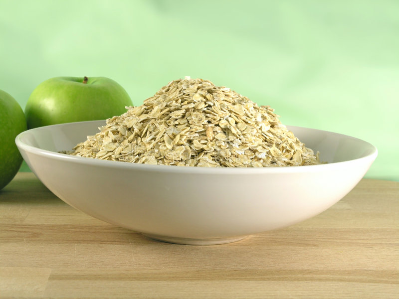 Oatmeal in bowl royalty free stock photos