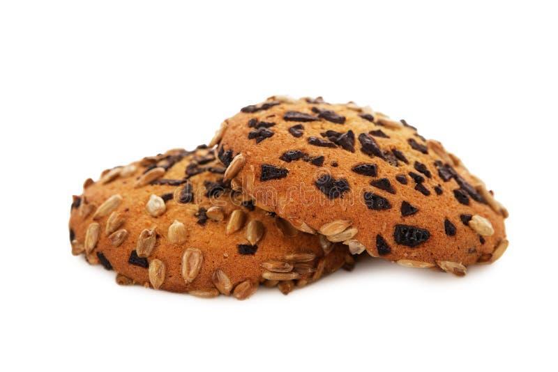 Oatmeal ciastka z Czekoladowymi układami scalonymi i słonecznikowymi ziarnami odizolowywają fotografia royalty free