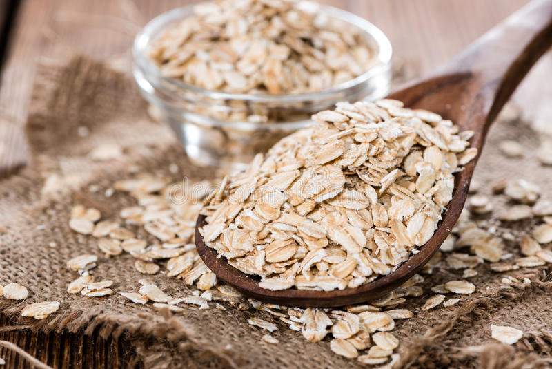 Oatmeal (close-up shot). Oatmeal (detailed close-up shot) on dark vintage wooden background stock images