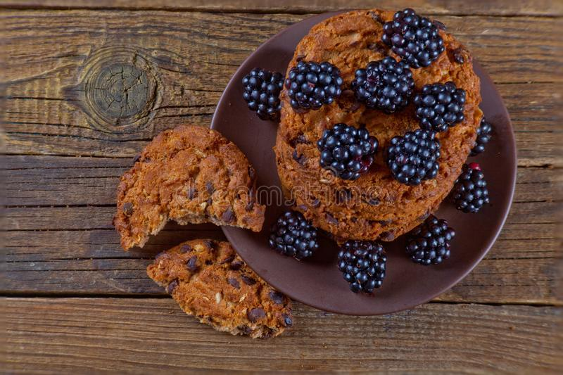 Oatmeal cookies with blackberries. View from above stock photography
