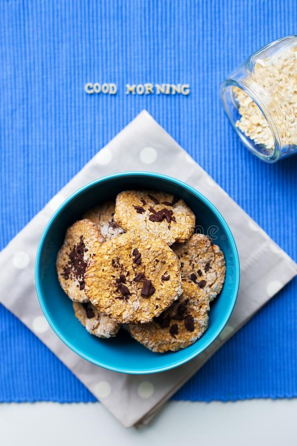 Oatmeal Cookies in blue plate that says good morning.  royalty free stock photography