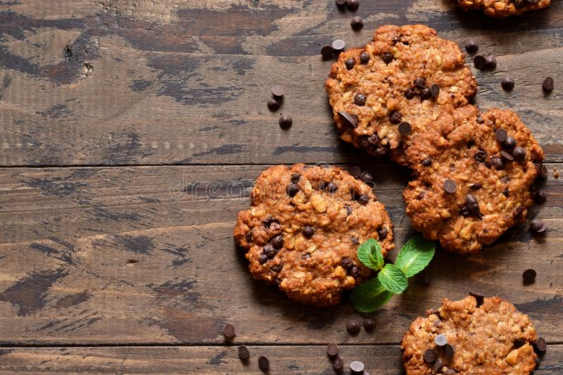 Oatmeal cookies with chocolate drops on a wooden background. View from above royalty free stock photography