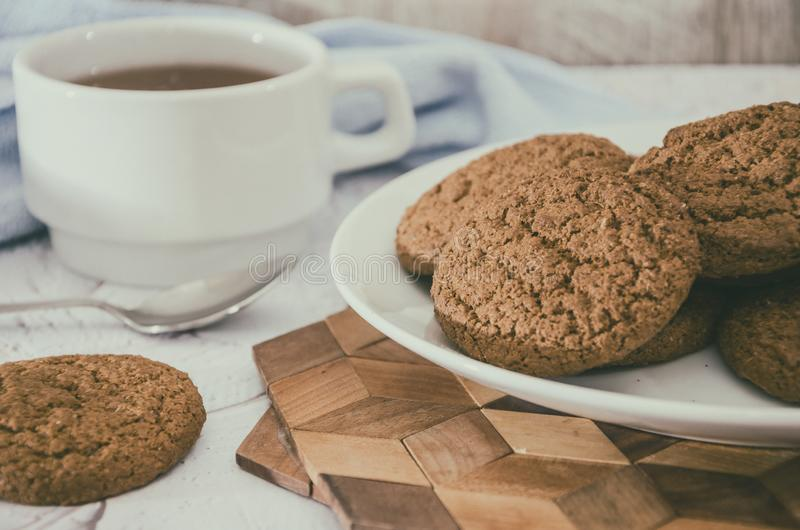 Oatmeal cookies and a cup of tea on the kitchen table. Morning tea party. royalty free stock images