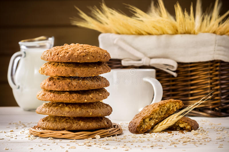 Oatmeal cookies and milk. On wooden table stock image