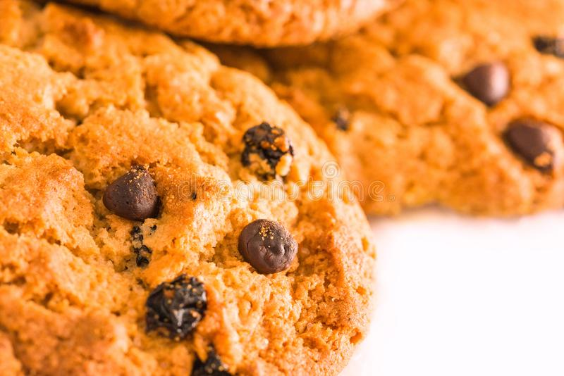 Oatmeal cookies with raisins and chocolate on a white background royalty free stock images